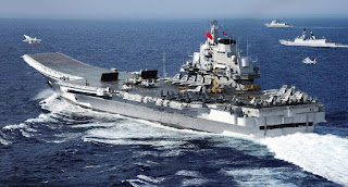 China's first aircraft carrier Liaoning has docked at its new permanent base in the northern port of Qingdao
