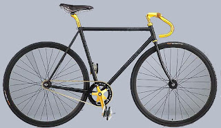 All black fixie with gold bull horns