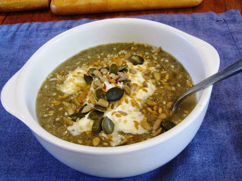 Leek and mushroom soup with yogurt and mixed seeds
