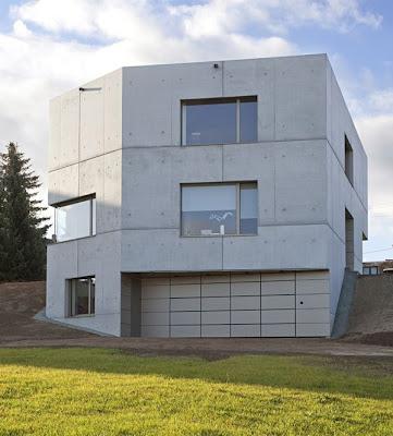 fachada de cemento en casa minimalista