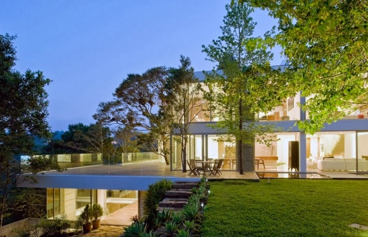 Modern dream home by Paz Arquitectura at night