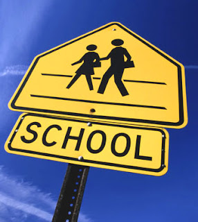 Yellow coloured, School traffic sign