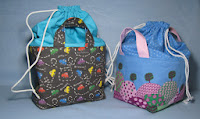 http://www.threadingmyway.com/2013/12/fabric-basket-with-drawstring-top.html