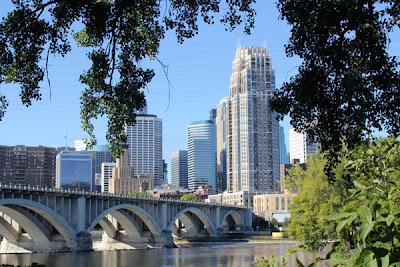 Minneapolis skyline near the stone arch bridge.
