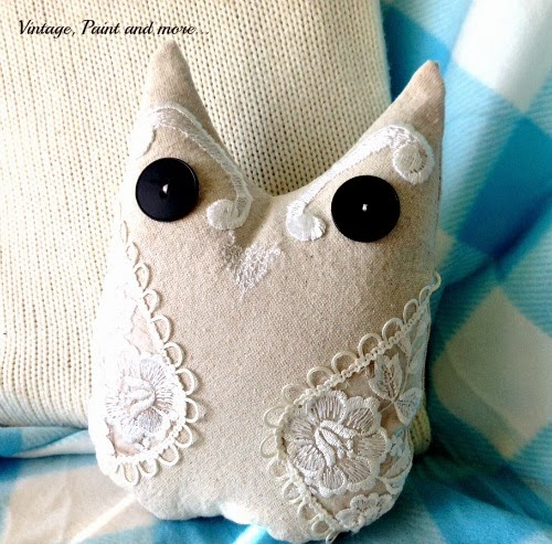 Drop Cloth Owl Pillow-completed owl pillow with lace embellishments and big black button eyes  on blue plaid blanket