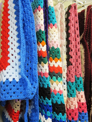 Selection of crocheted afghan rugs at Vinnies' Queanbeyan op shop.