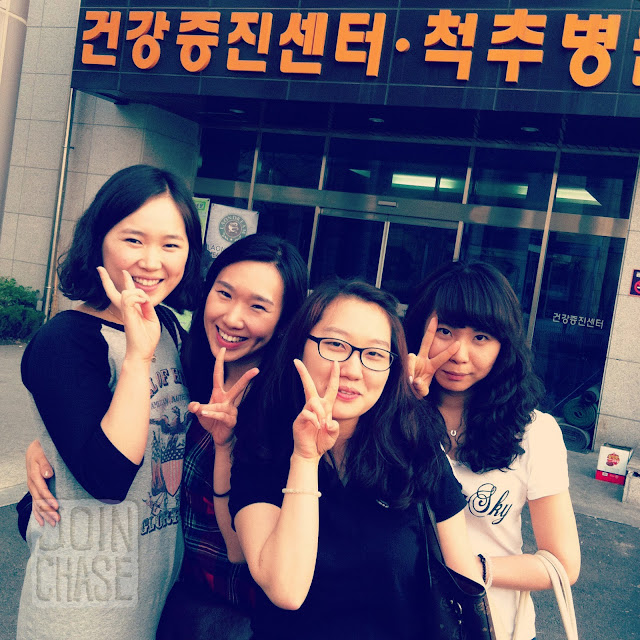 Korean nurses and staff posing for a photo outside Hana Hospital in Cheongju, South Korea.