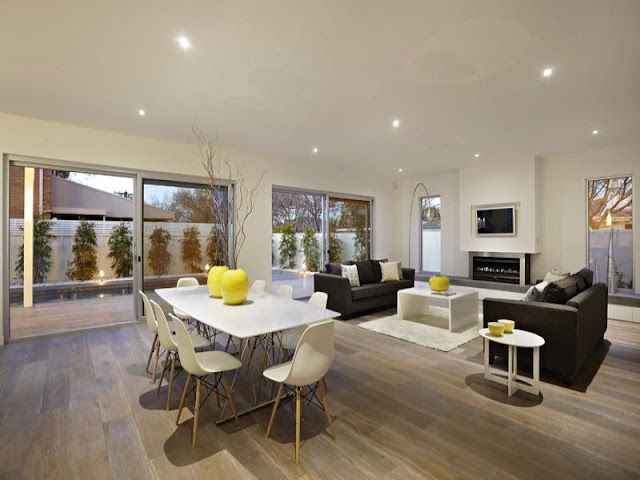 Photo of dinning table and the living room in the background in an amazing home in Australia
