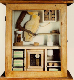 Glass Display Box by Joseph Cornell containing picture of cockatoo and assorted objects