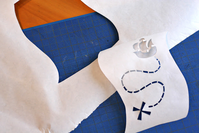 cut out a design from freezer paper to stencil a t shirt