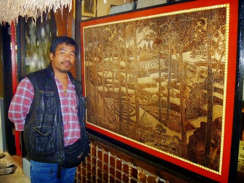 pelukis dari filipina yang menggunakan kaca pembesar