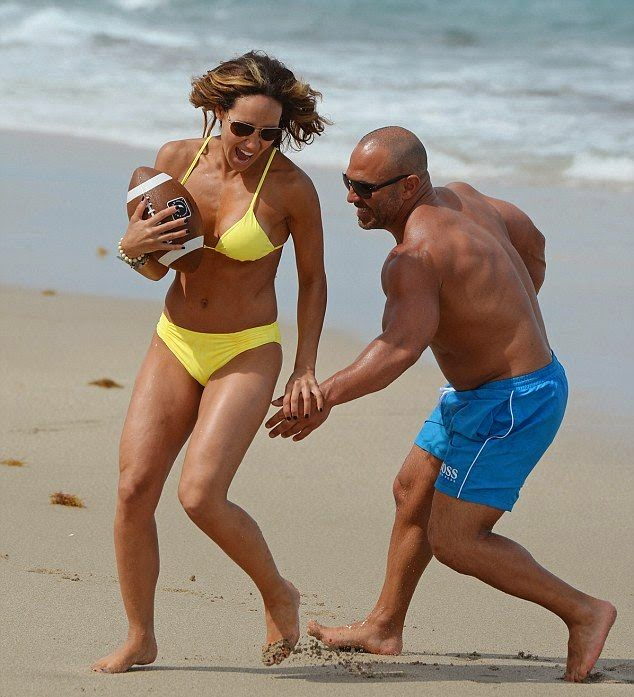 Melissa Gorga displays a Yellow Bikini to playing American Football at Miami on Friday, April 18, 2014
