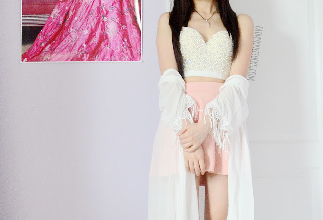 A boho-inspired cute summer outfit, with SheIn's longline tassel fringed kimono, beaded bustier top, and a pastel pink skater skirt.