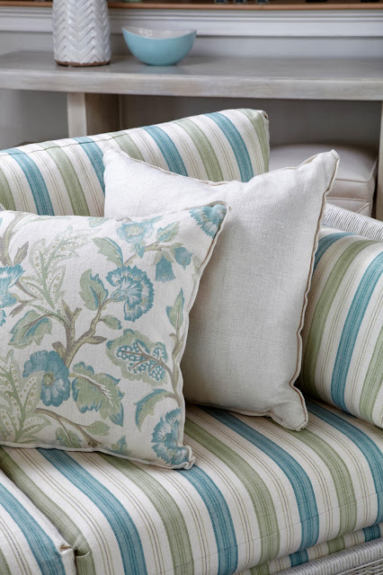 plain, stripes, and flowery pattern on the sofa and throws