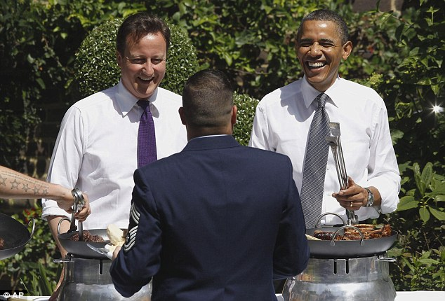 President and PM dish up burgers at 'Obama-Q' honouring American and British veterans