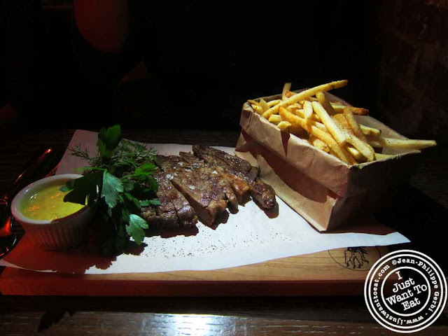 Image of Ribeye, fries and bearnaise sauce at Courgette next to Dream Hotel Midtown in NYC, New York