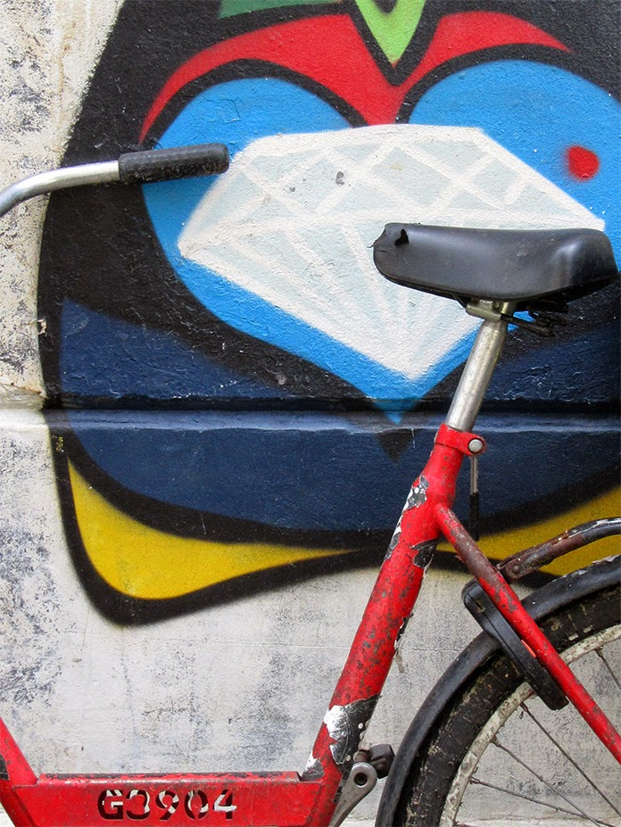 red bike against a mural