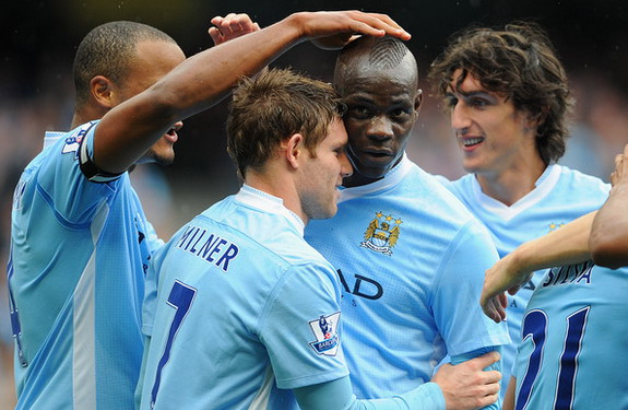 Mario Balotelli celebrates a goal with James Milner and his then Manchester City teammates