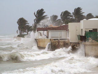 Hurricane hits homes at the beach.