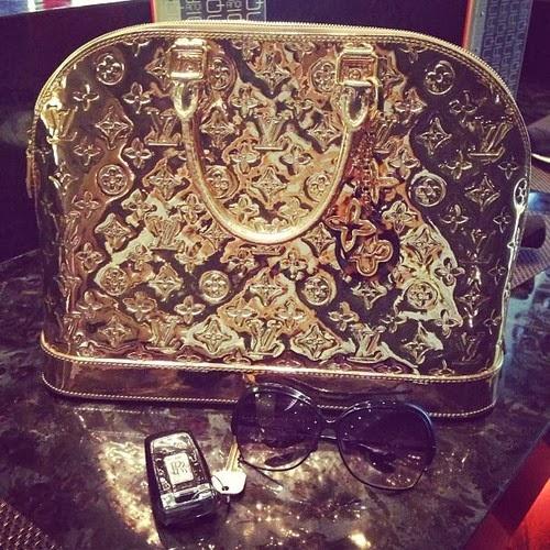 gold Louis Vuitton bag