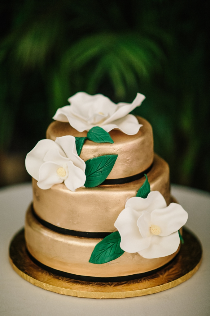 beautiful gold wedding cake with giant magnolia flower details