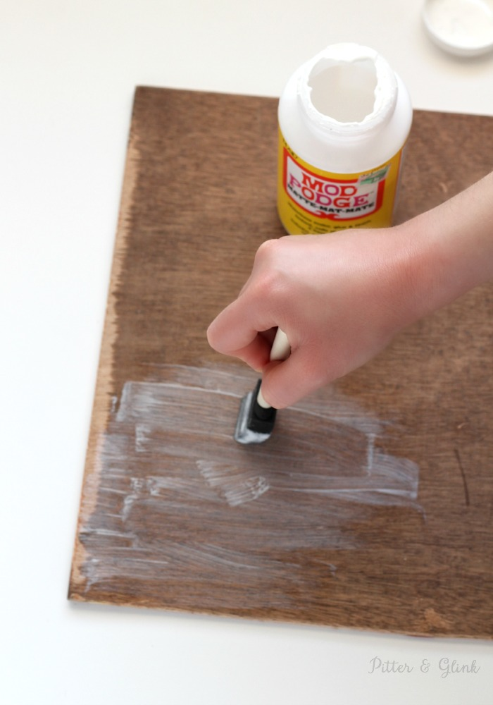 Mod Podge is great for adhering paper to all types of materials. pitterandglink.com