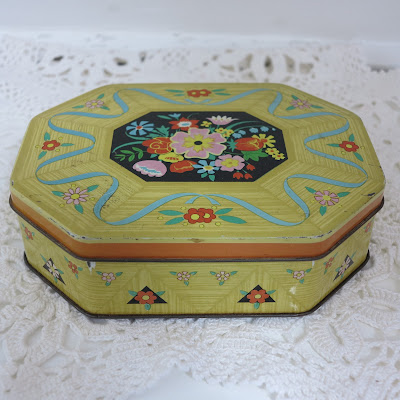 yellow tin with flowers, crochet doily, thrifted, vintage