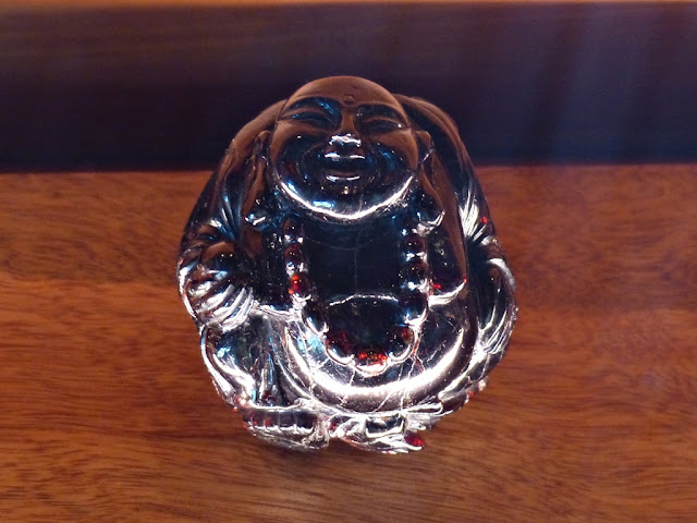 Happy Buddha carved from garnet