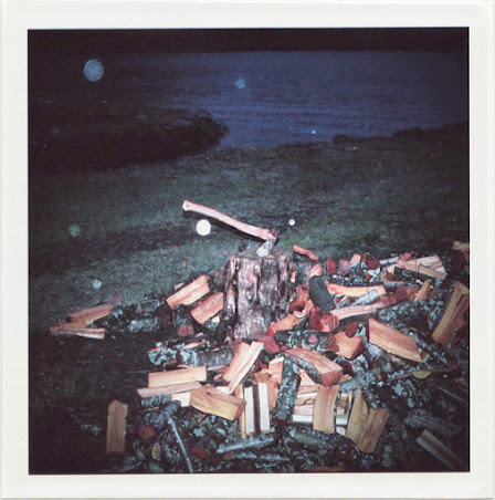 dirty photos - time - cretan landscape photo of hatchet  and cut wood