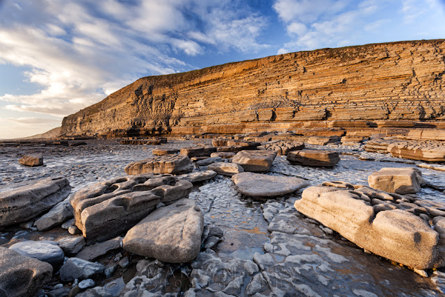 Dunraven Bay cliffs in the warm evening sunlight in the South Wales coast by Martyn Ferry Photography