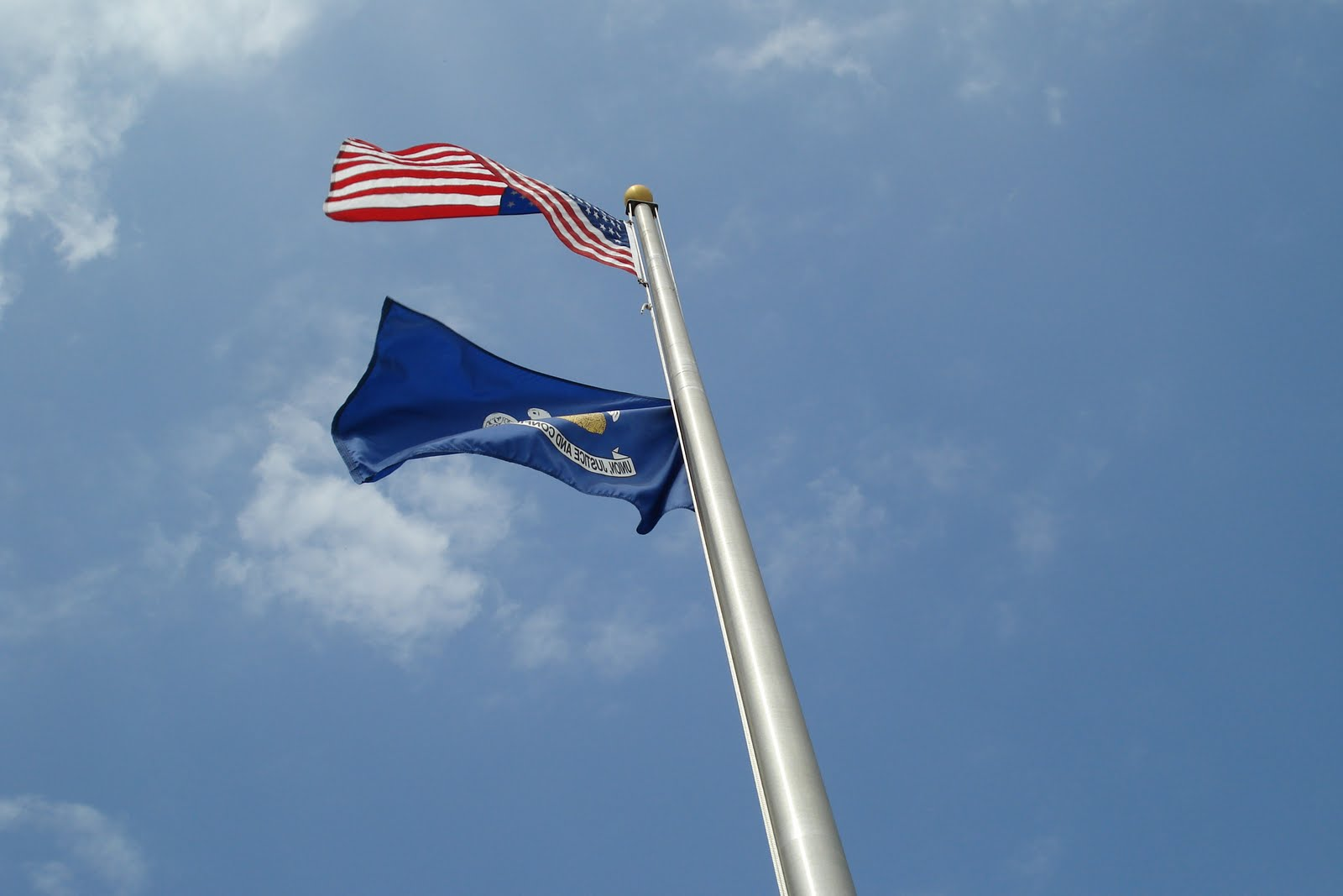 US and Louisiana flags both should fly