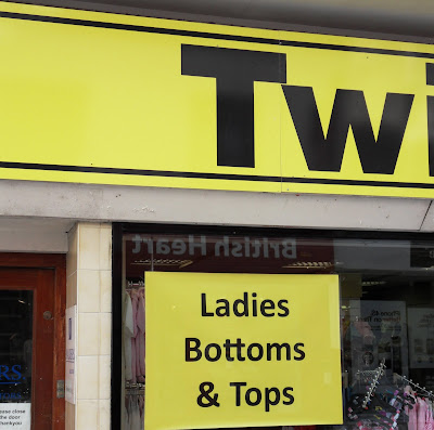 Bottoms and tops shop window sign