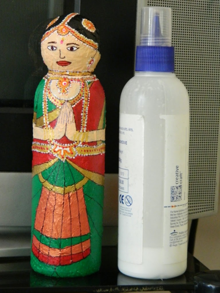Plastic bottle doll bharat natyam yellow craft for Craft from waste