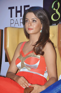 Surveen Chawla promotes Hate Story 2 in Hyedrabad in Lovely Orange Dress HQ Pics