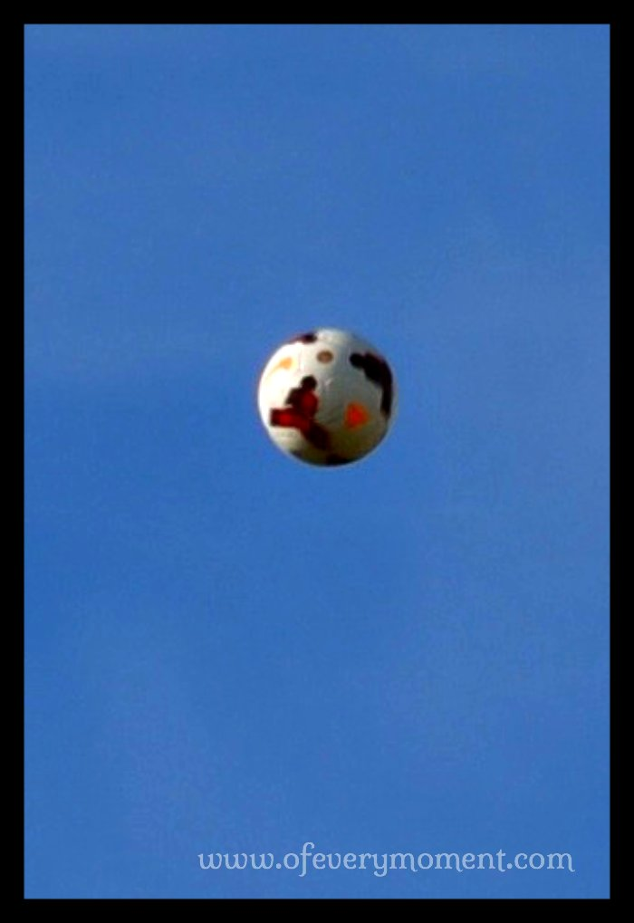 A soccer ball high in the air