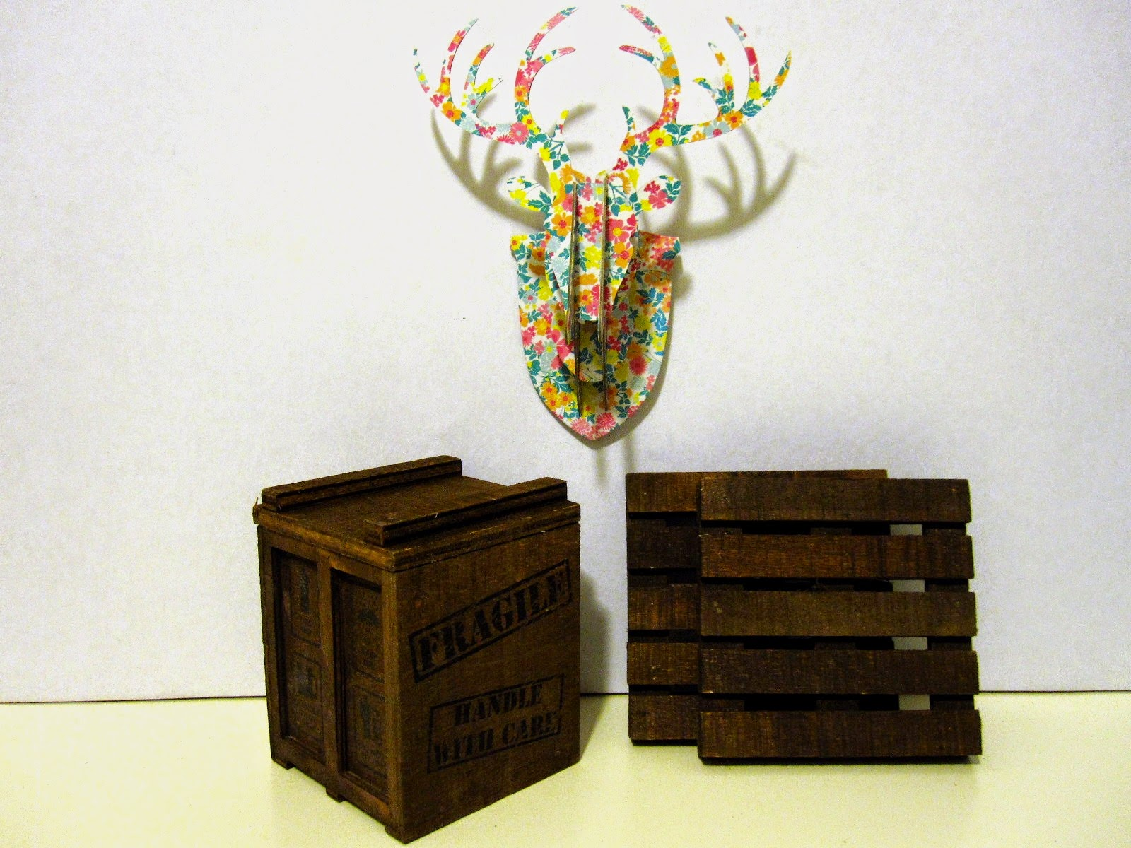 Miniature Typo cardboard stag head, wooden packing  crate and pallets.