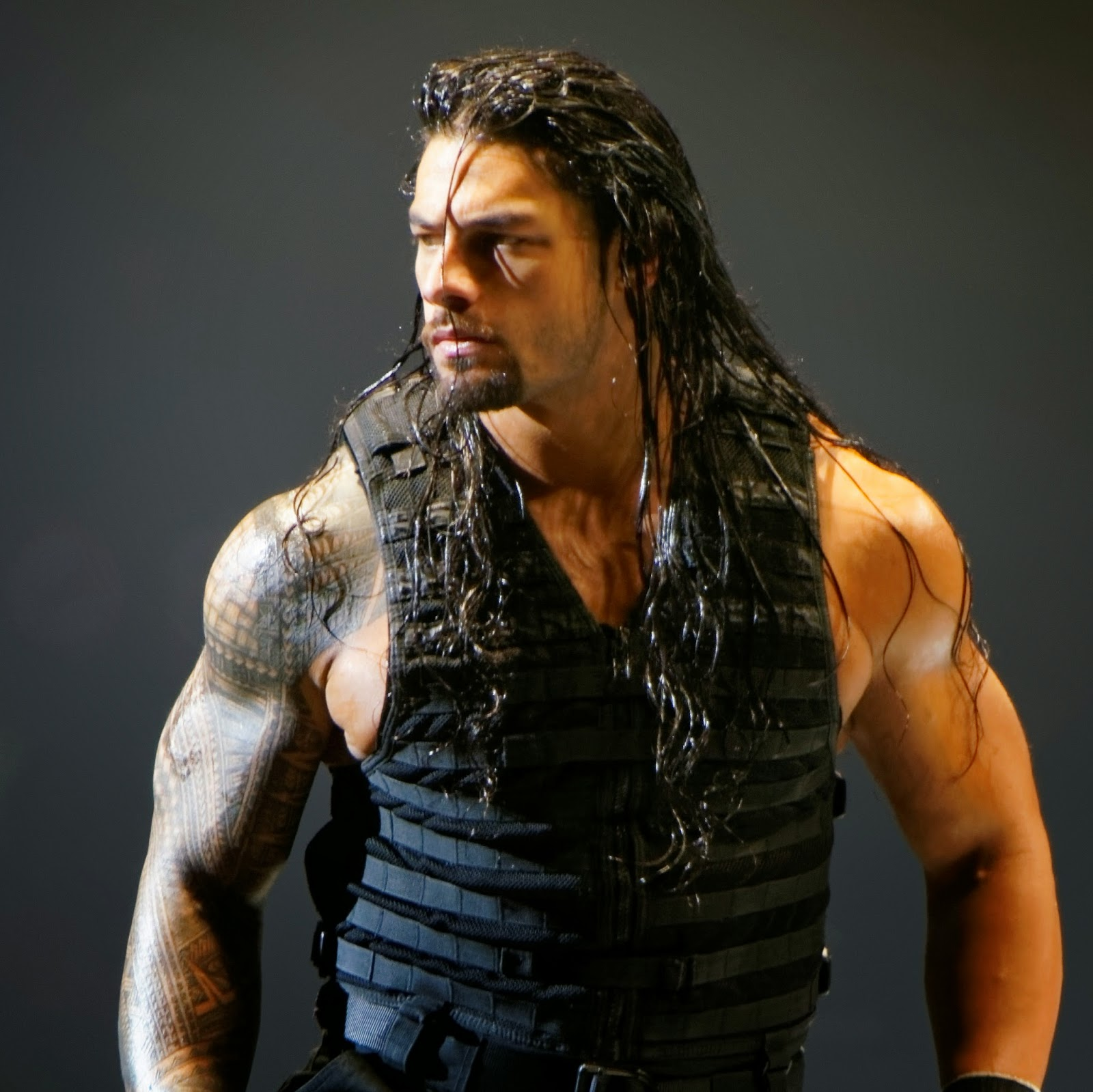 Roman Reigns Posing Shield Muscles