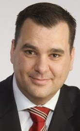 The Honourable James Moore, Minister of Industry.