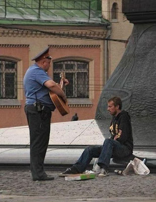 Funny picture policeman with a gitar