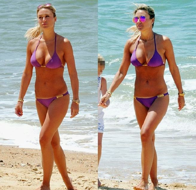 The 32-year-old got into the tropical spirit of things enjoying a sunshine by herself in Portugal on Tuesday, may 29, 2014.