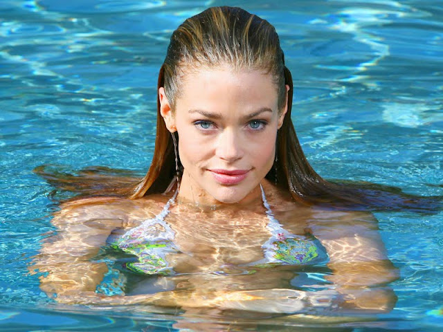 Denise Richards sexy in swimwear queen