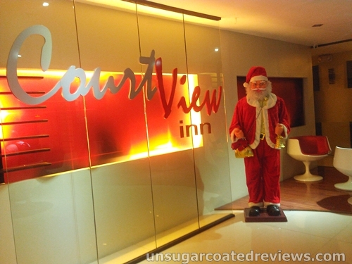 thin Santa Claus at the lobby of Courtview Inn