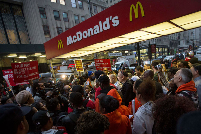 Fast-Food Workers Seeking $15 Wage Plan Civil Disobedience at Strikes