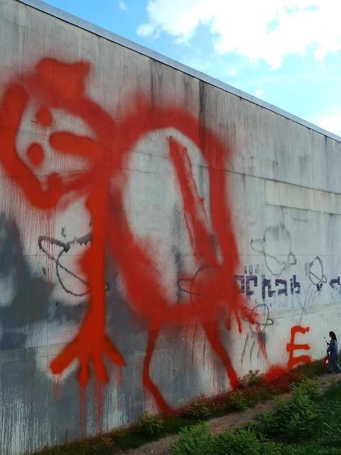 street artist ella and pitr working on a new street art mural in saint etienne france