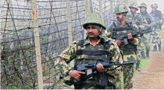 BSF Soldiers patrol along the India-Pakistan border