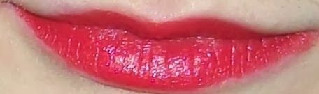 natural collection lipstick swatch in crimson