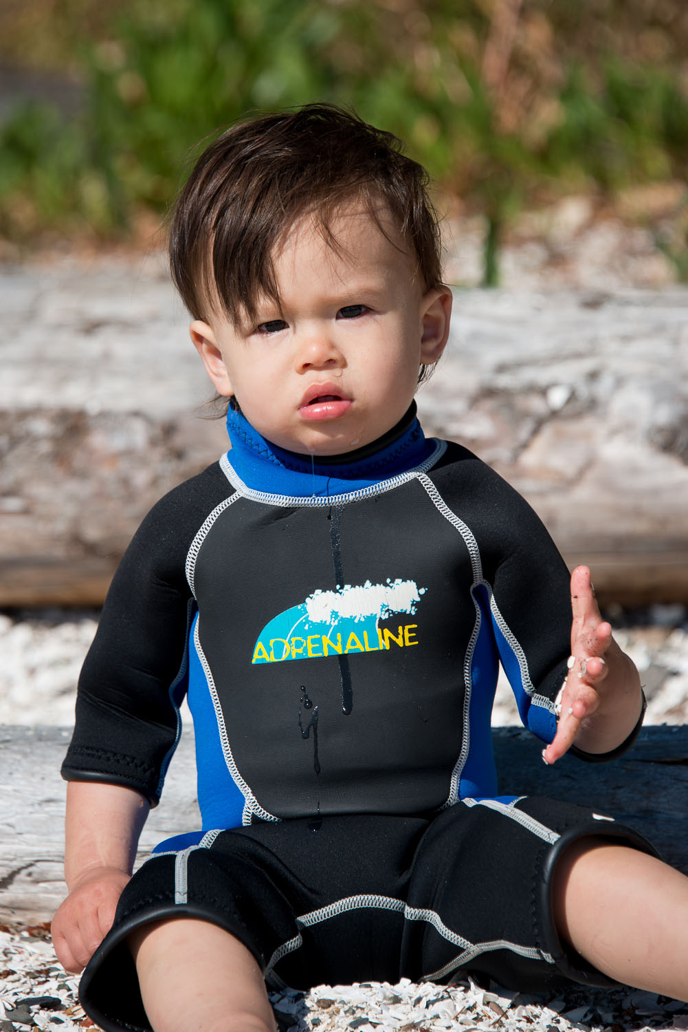 Hemingway modeling his wet suit while on Blackberry point
