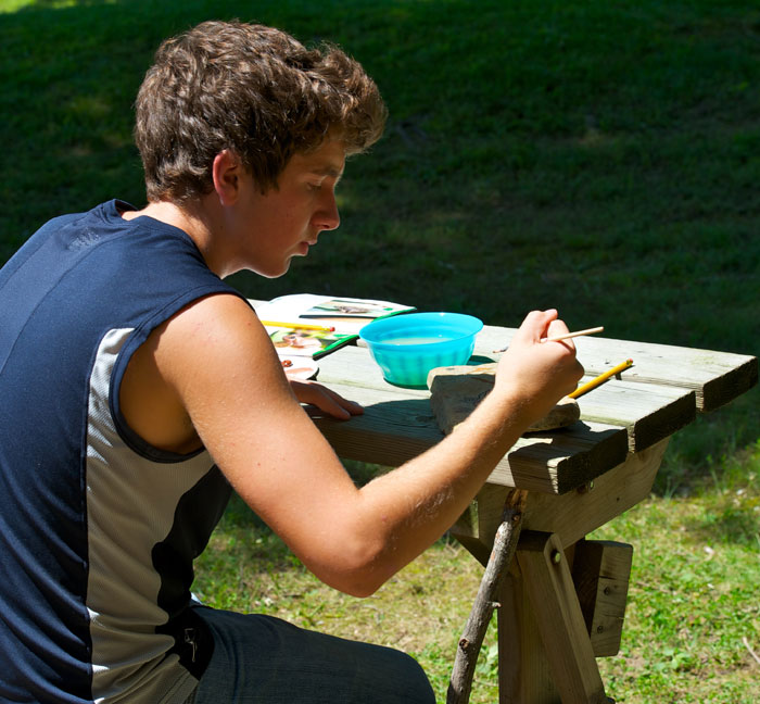 Matthew Riccetti painting after everyone is finished. Matty is a volunteer during the summer for Jenny Richards at the park.