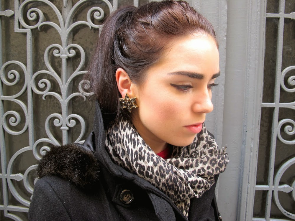 Fashion blogger Emma Louise Layla wearing star statement earrings