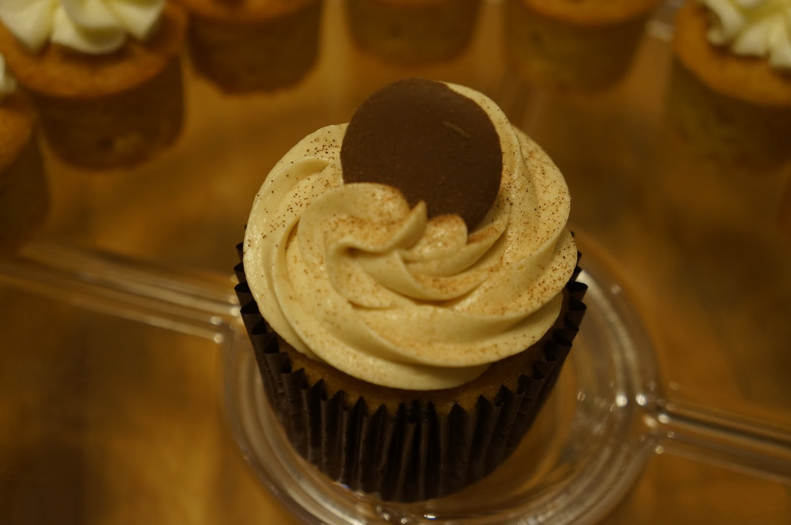 Coffee cake cupcake....sprinkled with chocolate and topped with a ...